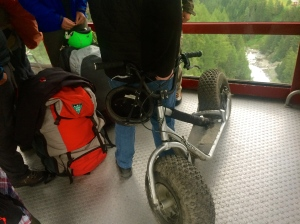 Funky rugged scooters and paragliding packs heading up the mountain