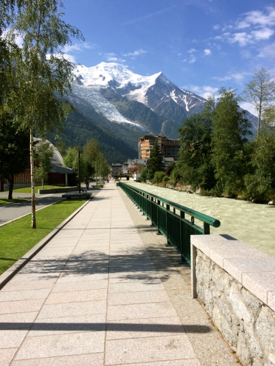 Prom. du Fori along the L'Arve leading to the city center in Chamonix. Mont Blanc overhead