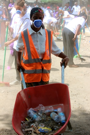 Cleaning up the market and providing donated equipment for the women who clean there